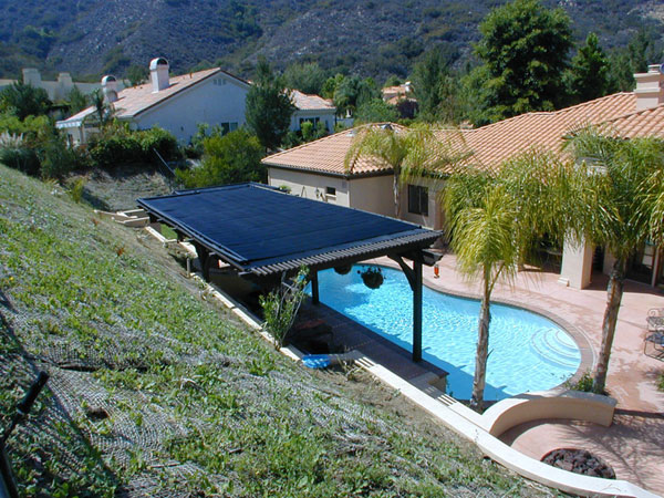 Heliocol solar pool heating panels installed on a patio roof.